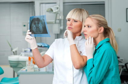 woman dentist with her assistant