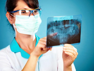 Dentist studying an x-ray